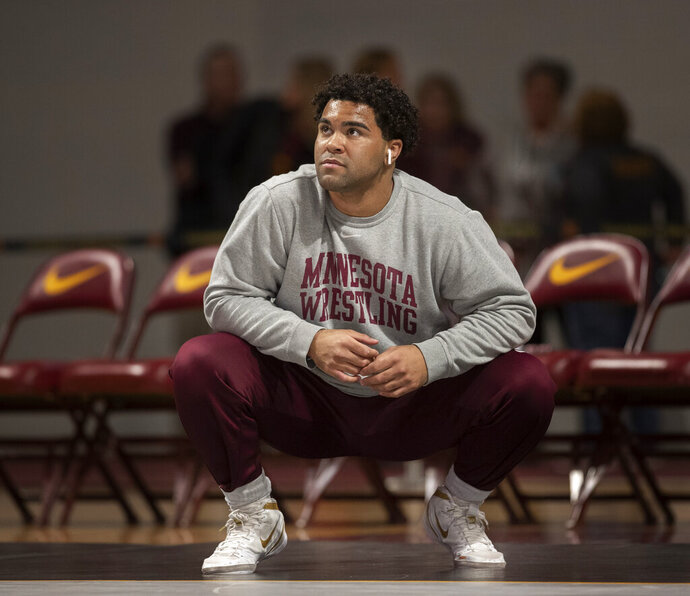 Gable Steveson warms up before wrestling in an NCAA Big Ten tournament in Minneapolis, Minn, Sunday, Jan. 6, 2019.  Nationally-ranked University of Minnesota heavyweight wrestler Gable Steveson and a teammate have been arrested on suspicion of criminal sexual conduct.  KSTP-TV reports that jail records show Steveson and Dylan Martinez were arrested Saturday night, June 15, 2019, at different times and places in Minneapolis. (Jerry Holt/Star Tribune via AP)
