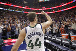 Utah Jazz forward Bojan Bogdanovic (44) pumps his fist to the fans after scoring the winning shot in the team's NBA basketball game against the Milwaukee Bucks on Friday, Nov. 8, 2019, in Salt Lake City. (AP Photo/Rick Bowmer)