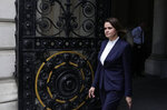 Belarus opposition leader Sviatlana Tsikhanouskaya arrives in Downing Street for a meeting with the British Prime Minister Boris Johnson in London, Tuesday, Aug. 3, 2021. (AP Photo/Alastair Grant)