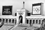 FILE - In this July 28, 1984, file photo, the Olympic flame is flanked by scoreboards signifying the formal opening of the Summer Olympic Games after it was lit by Rafer Johnson during the opening ceremonies in the Los Angeles Memorial Coliseum in Los Angeles. (AP Photo/Eric Risberg, File)