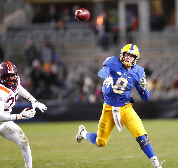 Pittsburgh quarterback Kenny Pickett (8) gets a pass off as Virginia Tech defensive back Divine Deablo (25) pursues in the fourth quarter of an NCAA football game, Saturday, Nov. 10, 2018, in Pittsburgh. Pittsburgh won 52-22.(AP Photo/Keith Srakocic)