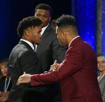 CORRECTS TO OKLAHOMA, INSTEAD OF OKLAHOMA STATE - Oklahoma quarterback Kyler Murray, left, is congratulated by Alabama's Tua Tagovailoa after Murray won the Heisman Trophy on Saturday, Dec. 8, 2018 in New York. (Todd J. Van Emst/Heisman Trophy Trust via AP, Pool)