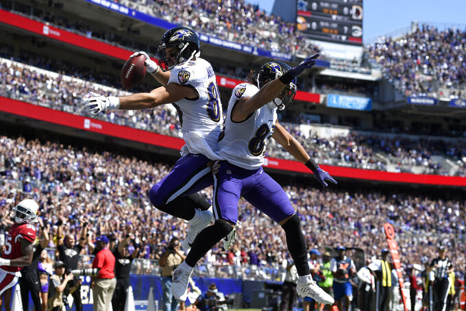 Baltimore Ravens tight end Mark Andrews, left, celebrates his touchdown with teammate Willie Snead in the first half of an NFL football game against the Arizona Cardinals, Sunday, Sept. 15, 2019, in Baltimore. (AP Photo/Gail Burton)