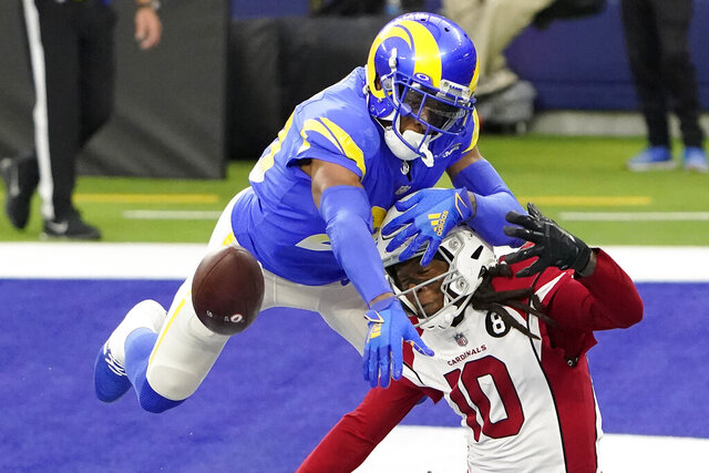 Los Angeles Rams cornerback Jalen Ramsey (20) defends a pass intended for Arizona Cardinals wide receiver DeAndre Hopkins (10) during the second half of an NFL football game in Inglewood, Calif., Sunday, Jan. 3, 2021. (AP Photo/Jae C. Hong)