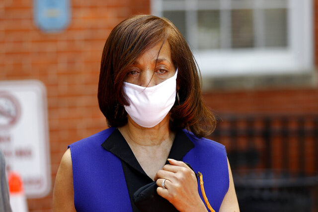 "Former Baltimore Mayor Catherine Pugh leaves the Anne Arundel County Circuit Court in Annapolis, Md., after pleading guilty to a state perjury charge Friday, June 19, 2020, for failing to disclose a business interest relating to her ""Healthy Holly"" children's books on her financial disclosure forms when she was a state senator. Pugh, a 70-year-old Democrat, already has been sentenced to three years in federal prison for netting hundreds of thousands of dollars in the self-dealing scandal over the books that touted exercise and nutrition. (AP Photo/Julio Cortez)"