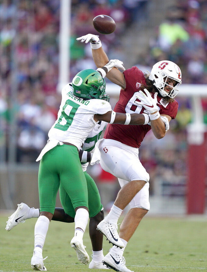 Oregon safety Jevon Holland (8) breaks up a pass for Stanford tight end Colby Parkinson (84) during the second half of an NCAA college football game Saturday, Sept. 21, 2019, in Stanford, Calif. (AP Photo/Tony Avelar)