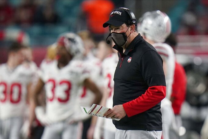 Ohio State head coach Ryan Day watches his team during the first half of an NCAA College Football Playoff national championship game against Alabama, Monday, Jan. 11, 2021, in Miami Gardens, Fla. (AP Photo/Chris O'Meara)