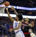 North Carolina's Coby White (2) drives past Louisville's Malik Williams (5) during the second half of an NCAA college basketball game in the Atlantic Coast Conference tournament in Charlotte, N.C., Thursday, March 14, 2019. (AP Photo/Nell Redmond)