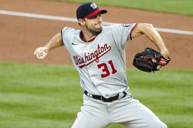 Washington Nationals' Max Scherzer (31) delivers a pitch during the first inning of a baseball game against the New York Mets Tuesday, Aug. 11, 2020, in New York. (AP Photo/Frank Franklin II)