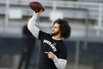 FILE - In this Nov. 16, 2019, file photo, free agent quarterback Colin Kaepernick participates in a workout for NFL football scouts and media in Riverdale, Ga. Kaepernick was a second-round draft pick in 2011 who the next year led the San Francisco 49ers to the Super Bowl. By 2016, he had begun kneeling on the sideline at games during the national anthem to protest social injustice and police brutality.  Soon after, he was gone from the NFL, and he has not played since. (AP Photo/Todd Kirkland, File)