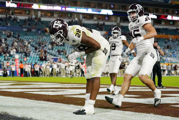 Texas A&M running back Isaiah Spiller (28) takes a bow after scoring a touchdown during the first half of the Orange Bowl NCAA college football game against North Carolina, Saturday, Jan. 2, 2021, in Miami Gardens, Fla.(AP Photo/Lynne Sladky)