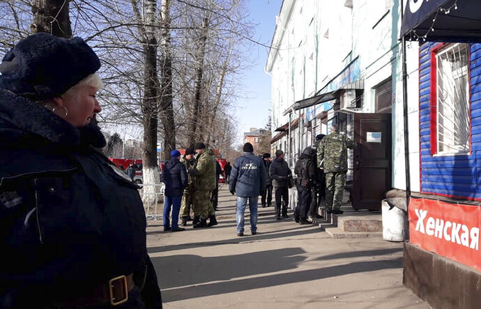 In this photo provided by Vera Zaderko, police secure an area at a college in Blagoveshchensk, Russia, Thursday, Nov. 14, 2019. Russia's state Investigative Committee said the 19-year-old college student in Blagoveshchensk near the border with China brought a hunting rifle to class Thursday and opened fire on students, shooting one dead and severely injuring three more. It wasn't immediately clear what prompted the attack. The attacker shot himself soon after the police arrived. (Vera Kulikova via AP)