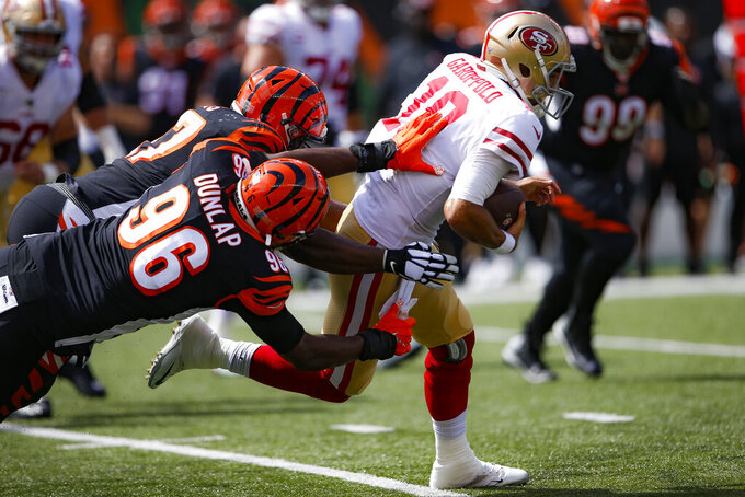San Francisco 49ers quarterback Jimmy Garoppolo (10) runs the ball against Cincinnati Bengals defensive end Carlos Dunlap (96) during the first half an NFL football game, Sunday, Sept. 15, 2019, in Cincinnati. (AP Photo/Gary Landers)