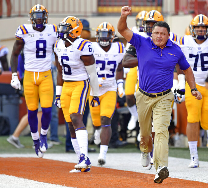 LSU coach Ed Orgeron takes the field with his players for an NCAA college football game against Texas on Saturday, Sept. 7, 2019, in Austin, Texas. (Hilary Scheinuk/The Advocate via AP)