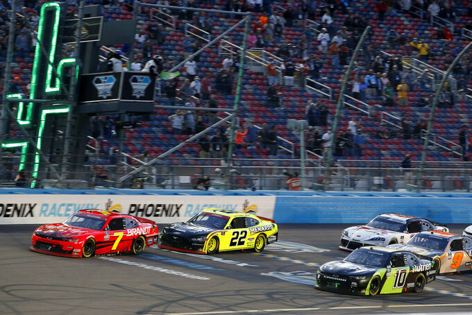 Justin Allgaier (7), Austin Cindric (22) and Ross Chastain (10) lead the field on a restart during the NASCAR Xfinity Series auto race at Phoenix Raceway, Saturday, Nov. 7, 2020, in Avondale, Ariz. (AP Photo/Ralph Freso)