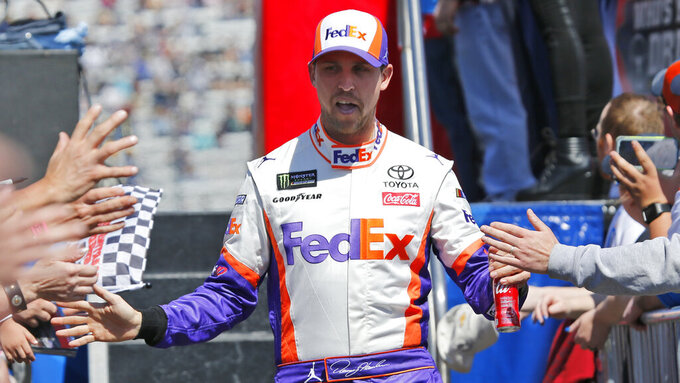 NASCAR Cup Series driver Denny Hamlin (11) greets fans during driver introductions prior to the NASCAR Cup Series auto race at the Martinsville Speedway in Martinsville, Va., Sunday, March 24, 2019. (AP Photo/Steve Helber)
