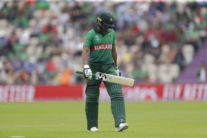 Bangladesh's Shakib Al Hasan walks off the field of play after losing his wicket from the bowling of Afghanistan's Mujeeb Ur Rahman during the Cricket World Cup match between Bangladesh and Afghanistan at the Hampshire Bowl in Southampton, England, Monday, June 24, 2019. (AP Photo/Matt Dunham)