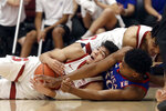 Stanford guard Tyrell Terry, bottom left, tries to control the ball under teammate Spencer Jones, top, and Kansas guard Ochai Agbaji during the first half of an NCAA college basketball game in Stanford, Calif., Sunday, Dec. 29, 2019. (AP Photo/Jeff Chiu)