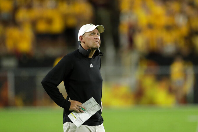 Sacramento State coach Troy Taylor watches the clock during the first half of the team's NCAA college football game Arizona State, Friday, Sept. 6, 2019, in Tempe, Ariz. (AP Photo/Matt York)