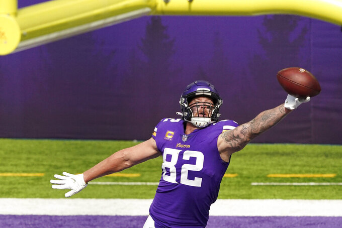 Minnesota Vikings tight end Kyle Rudolph (82) made a one-handed touchdown catch during the second half of an NFL football game against the Tennessee Titans, Sunday, Sept. 27, 2020 in Minneapolis. (Anthony Souffle/Star Tribune via AP)