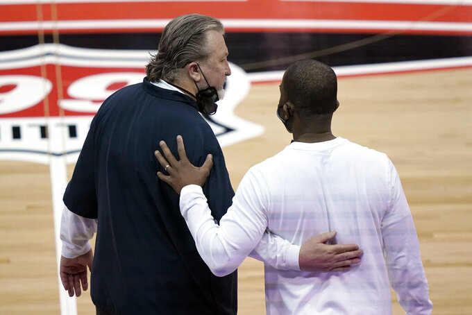 West Virginia head coach Bob Huggins, left, and Oklahoma State head coach Mike Boynton great each other after an NCAA college basketball game in the second round of the Big 12 Conference tournament in Kansas City, Mo., Thursday, March 11, 2021. Oklahoma State won 72-69. (AP Photo/Charlie Riedel)