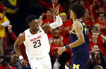 Maryland forward Bruno Fernando (23), of Angola, gestures in front of Michigan guard Jordan Poole after making a basket in the first half of an NCAA college basketball game, Sunday, March 3, 2019, in College Park, Md. (AP Photo/Patrick Semansky)