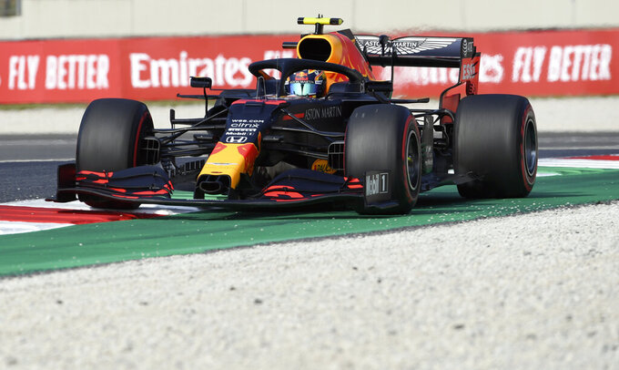 Red Bull driver Alexander Albon of Thailand steers his car during a practice session ahead of the Grand Prix of Tuscany at the Mugello circuit in Scarperia, Italy, Friday, Sept. 11, 2020. The Formula One Grand Prix of Tuscany will take place on Sunday. (Claudio Giovannini, Pool Photo via AP)