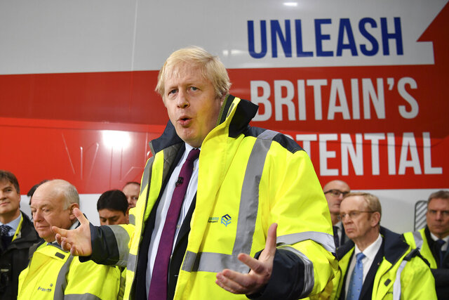 Britain's Prime Minister Boris Johnson talks during a question and answer session, part of a General Election campaign visit to Ferguson's Transport in Washington, England, Monday, Dec. 9, 2019. Britain goes to the polls on Dec. 12. (Ben Stansall/Pool Photo via AP)