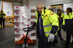 Britain's Prime Minister Boris Johnson visits the headquarters of Iceland Foods in Deeside, Wales, Friday Nov. 8, 2019. Johnson pushed hard for the early election, which is coming more than two years ahead of schedule, after Parliament thwarted his plans to have Britain leave the EU on Oct. 31. Johnson hopes to win an outright majority in Parliament so he can pass a divorce bill in time for Britain to leave by the next Brexit deadline on Jan. 31. (Daniel Leal-Olivas/Pool via AP)