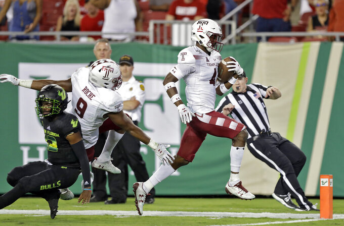 Temple linebacker Sam Franklin (4) runs a South Florida fumble back for a touchdown during the second half of an NCAA college football game Thursday, Nov. 7, 2019, in Tampa, Fla. (AP Photo/Chris O'Meara)