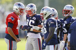 New England Patriots quarterback Tom Brady (12), left, calls a play during a combined NFL football training camp with the Tennessee Titans Thursday, Aug. 15, 2019, in Nashville, Tenn. (AP Photo/Mark Humphrey)