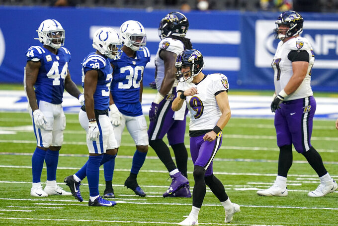 Baltimore Ravens kicker Justin Tucker (9) celebrates a field goal against the Indianapolis Colts in the second half of an NFL football game in Indianapolis, Sunday, Nov. 8, 2020. (AP Photo/Darron Cummings)