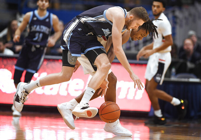 Maine's Nedeljko Prijovic, left, and Connecticut's Brendan Adams, back right, chase the ball during the second half of an NCAA college basketball game Sunday, Dec. 1, 2019, in Hartford, Conn. (AP Photo/Jessica Hill)