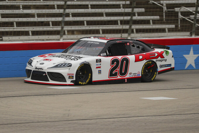 Harrison Burton (20) drives on the front stretch during a NASCAR Xfinity Series auto race at Texas Motor Speedway in Fort Worth, Texas, Saturday Oct. 24, 2020. (AP Photo/Richard W. Rodriguez)