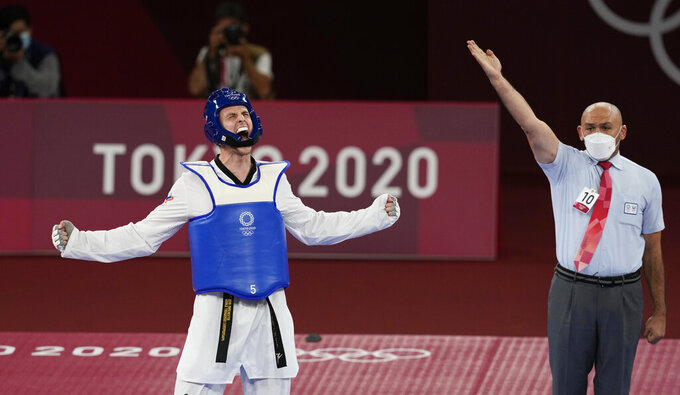 Vladislav Larin of the Russian Olympic Committee, left, reacts as the referee signals his win for a gold medal for taekwondo men's 80kg match at the 2020 Summer Olympics, Tuesday, July 27, 2021, in Tokyo, Japan. (AP Photo/Themba Hadebe)