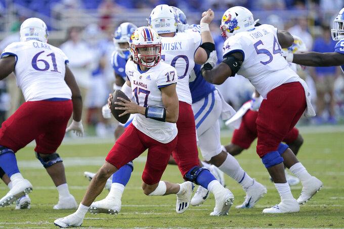Kansas quarterback Jason Bean (17) scrambles against Duke during the first half of an NCAA college football game in Durham, N.C., Saturday, Sept. 25, 2021. (AP Photo/Gerry Broome)