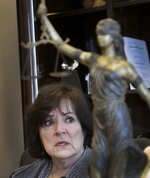 In this Wednesday, March 15, 2017 file photo, Oakland County Prosecuting Attorney Jessica Cooper speaks in her office in Pontiac, Mich. In his final days in office, former Michigan Gov. Rick Snyder erased the felony drunken-driving conviction of Jim Jagger who pleaded for a pardon so he could seek a lucrative promotion as the next president of the Michigan Association of Certified Public Accountants. Cooper, the Detroit-area prosecutor, smelled favoritism. She said Jagger's