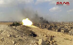 FILE - This file frame grab from a video released on Nov. 2, 2017 by the Syrian official news agency SANA shows a Syrian army tank firing during a battle against Islamic State militants in Deir el-Zour, Syria. The Islamic State group seemed largely defeated last year, with the loss of its territory, the killing of its founder in a U.S. raid and an unprecedented crackdown on its social media propaganda machine but tensions between the U.S. and Iran in the region provide a comeback opportunity for the extremist group. (SANA via AP, File)