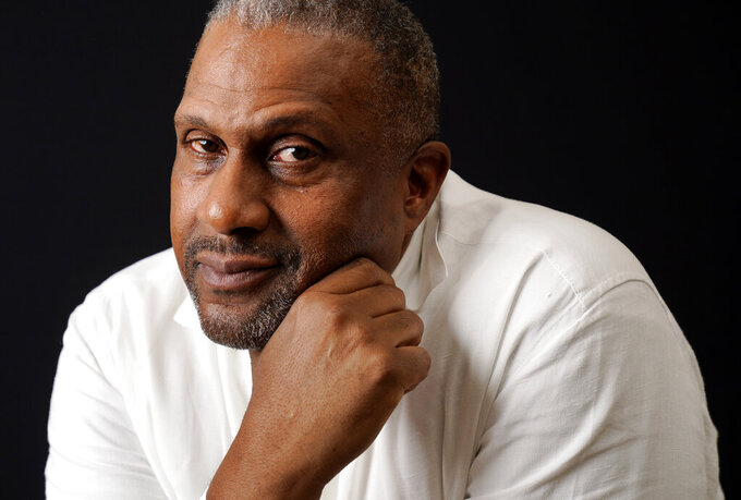 Tavis Smiley, owner of progressive talk radio station KBLA Los Angeles (1580), poses for a portrait in his station's offices, Tuesday, June 15, 2021, in Los Angeles. (AP Photo/Chris Pizzello)