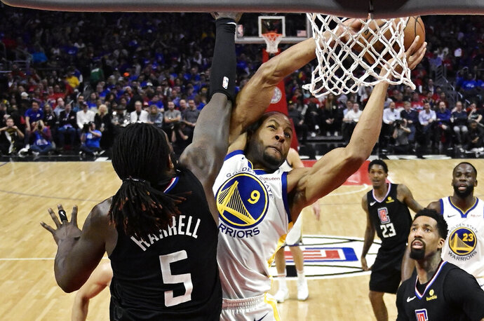 Golden State Warriors guard Andre Iguodala, right, shoots as Los Angeles Clippers forward Montrezl Harrell defends during the second half in Game 3 of a first-round NBA basketball playoff series Thursday, April 18, 2019, in Los Angeles. The Warriors won 132-105. (AP Photo/Mark J. Terrill)