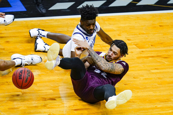 Villanova guard Bryan Antoine (1) and Winthrop guard Josh Corbin (32) go to the floor for a loose ball in the second half of a first round game in the NCAA men's college basketball tournament at Farmers Coliseum in Indianapolis, Friday, March 19, 2021. (AP Photo/Michael Conroy)