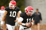 This Dec. 18, 2017 file photo shows Georgia NCAA college football quarterbacks Jake Fromm (11) and Jacob Eason (10) running a drill during a team practice in Athens, Ga. Eason lost his starting job for Georgia after he was injured in the first game of the season. The former five-star recruit has embraced his role as backup to freshman star Jake Fromm, but Eason acknowledges the difficulty of losing his job through no fault of his own. Georgia faces Oklahoma in the Rose Bowl on Jan. 1, 2018. (Joshua L. Jones/Athens Banner-Herald via AP)
