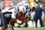 New England Patriots outside linebacker Dont'a Hightower (54) and New England Patriots defensive end Michael Bennett (77) sack Washington Redskins quarterback Colt McCoy (12) during the second half of an NFL football game, Sunday, Oct. 6, 2019, in Washington. (AP Photo/Nick Wass)