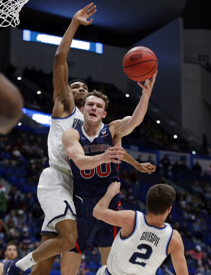 St. Mary's Tanner Krebs drives to the hoop against Villanova's Collin Gillespie (2) and Jermaine Samuels, left, during the first half of a first round men's college basketball game in the NCAA Tournament, Thursday, March 21, 2019, in Hartford, Conn. (AP Photo/Elise Amendola)