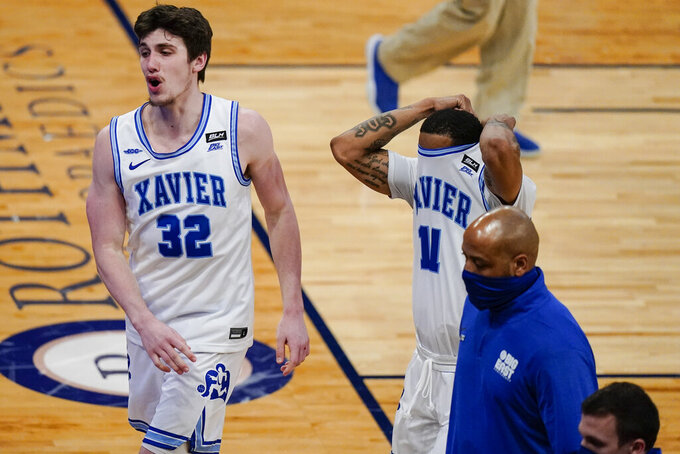 Xavier's Zach Freemantle (32) and Dwon Odom (11) react after losing to Butler in overtime of an NCAA college basketball game in the Big East conference tournament Wednesday, March 10, 2021, in New York. Butler won 70-69. (AP Photo/Frank Franklin II)