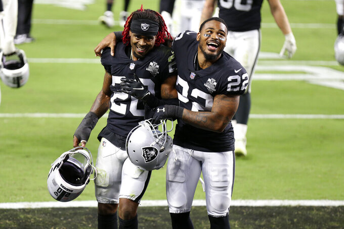 Las Vegas Raiders cornerback Damon Arnette, left, and cornerback Keisean Nixon celebrate after defeating the New Orleans Saints in an NFL football game, Monday, Sept. 21, 2020, in Las Vegas. (AP Photo/Isaac Brekken)