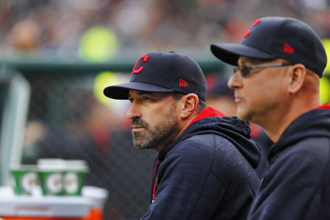 "FILE - Cleveland Indians pitching coach Mickey Callaway, left, watches with manager Terry Francona during the first inning of a baseball game against the Detroit Tigers, in Detroit, in this May 3, 2017, file photo. Indians manager Terry Francona said no one in the Cleveland organization ""covered up"" for former pitching coach Mickey Callaway, who is under investigation by Major League Baseball following allegations of sexual harassment. In a story Tuesday, March 2, 2021, The Athletic reported that 12 current and former Indians employees have come forward in the last month to say the Indians were aware of Callaway's inappropriate behavior while he was their pitching coach from 2013-17. (AP Photo/Paul Sancya, File)"