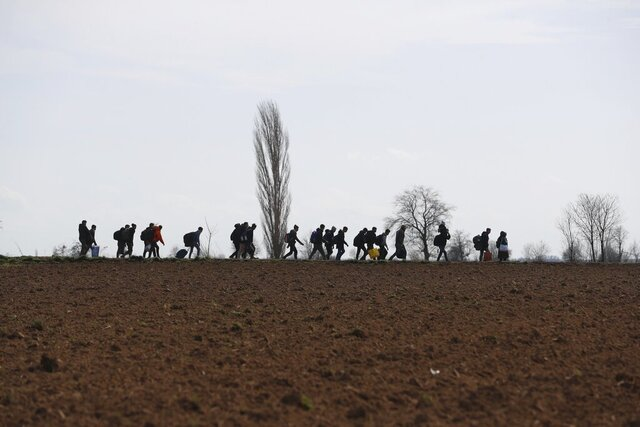 Migrants walk near the Pazarkule border gate in Edirne, at the Turkish-Greek border on Monday, March 2, 2020. Thousands of migrants and refugees massed at Turkey's western frontier, trying to enter Greece by land and sea after Turkey said its borders were open to those hoping to head to Europe. (AP Photo/Darko Bandic)