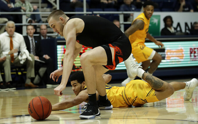 Oregon State's Tres Tinkle, left, and California's Matt Bradley reach for the ball in the second half of an NCAA college basketball game Saturday, Feb. 1, 2020, in Berkeley, Calif. (AP Photo/Ben Margot)