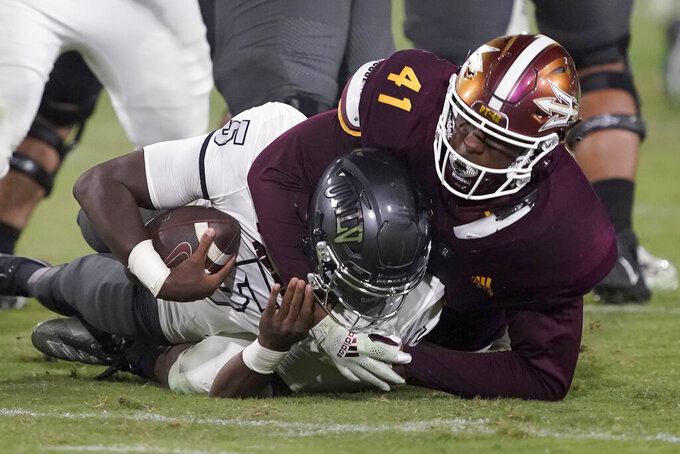 UNLV quarterback Justin Rogers (5) is sacked by Arizona State defensive lineman Tyler Johnson (41) during the second half of an NCAA college football game, Saturday, Sept. 11, 2021, in Tempe, Ariz. (AP Photo/Matt York)